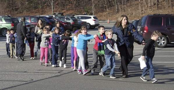 Children being led to safety Friday after the shooting