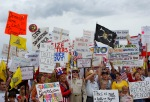 """People hold signs during a """"tea party"""" protest in Flagstaff,Arizona"""