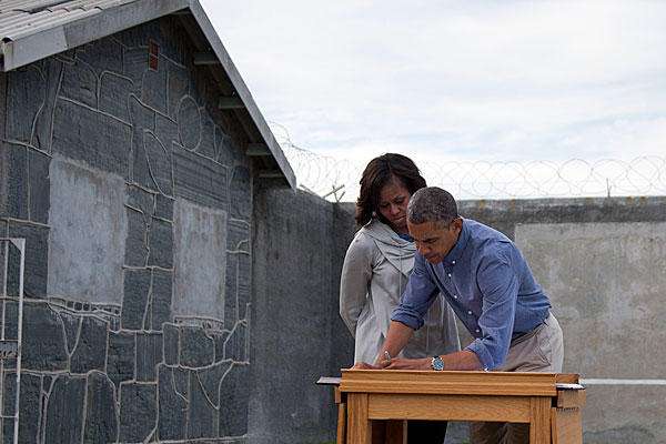 President Obama and Michelle visit Mandela's former prison