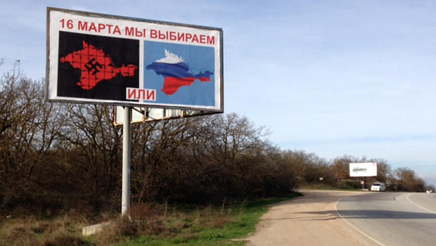 The choice?  The Crimea drapped with a Russian flag, or one with a black swastika!