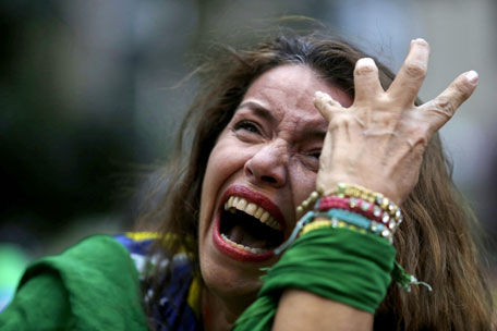 The agony on this woman's face captures the feelings of Brazilians as their team collapsed in the semi-finals
