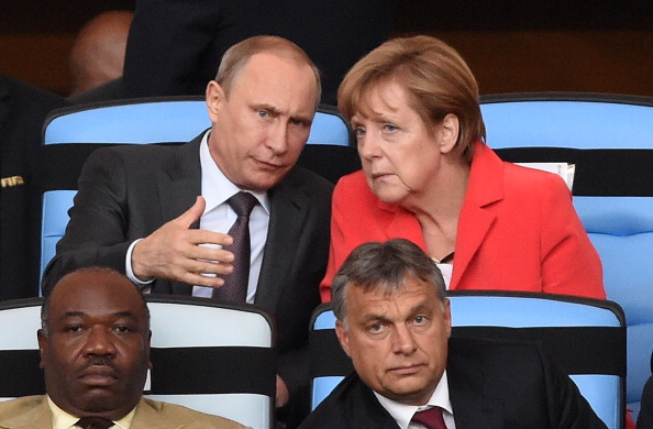 Putin and Merkel consult in Brazil during the World Cup finals.