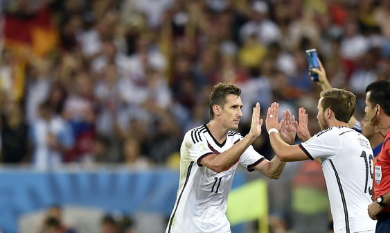 Klose leaves the game, greeting Mario Goetze, his sub and soon to be national hero