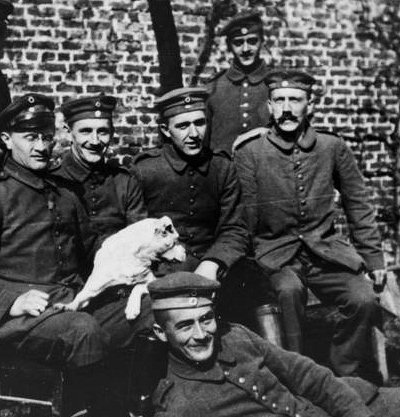 One brave WWI courier, seated far right, was so incensed by the loss of WWI that he went into politics - and instigated the second world war.