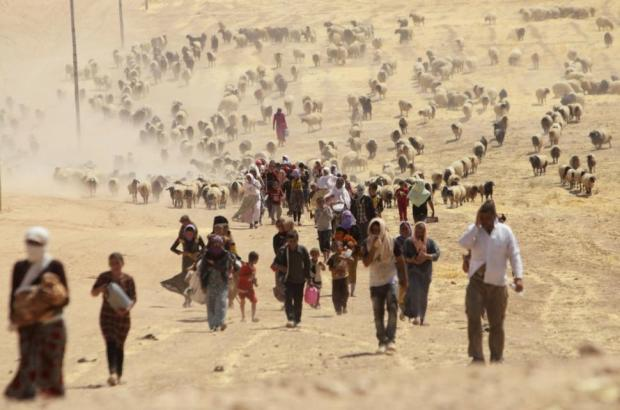 Yazidis fleeing ISIS, which slaughters, rapes and tortures minorities they see as not being true Muslims