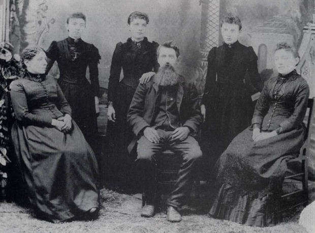 A pioneer family, part of the original De Smet, SD settlement.  Standing: Carrie, Laura, and Grace.  Seated: Caroline (Ma), Charles (Pa) and Mary.