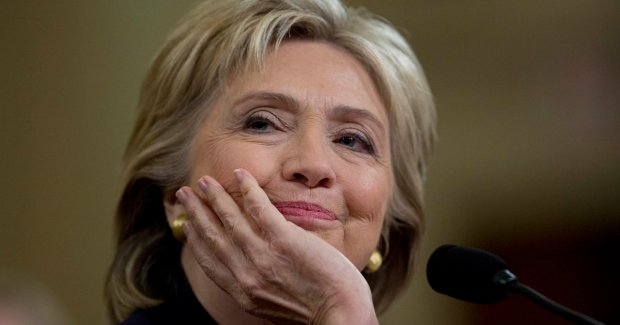 Hillary Clinton, former U.S. secretary of state and 2016 Democratic presidential candidate, smiles during a House Select Committee on Benghazi hearing in Washington, D.C., U.S., on Thursday, Oct. 22, 2015. Clinton said that she accepted responsibility for a lethal 2012 attack on the U.S. diplomatic mission in Benghazi, Libya and that she sought afterward to improve security for State Department workers abroad, as the House Benghazi panel investigating the incident began a hearing that may prove a turning point for her presidential campaign. Photographer: Andrew Harrer/Bloomberg via Getty Images